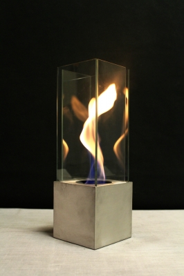 Outdoor fire feature with swirling flame